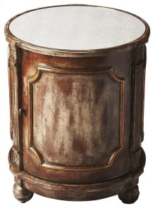 Add style and storage space to your living area with this gorgeous hand painted side drum table. Crafted from select solid wood and wood products, this lovely accent table in an Ash hand-painted finish boasts beautiful intricate carvings with an antiqued