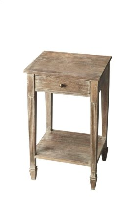 Crafted from acacia wood solids and wood products, this side table features exquisitely tapered and fluted legs ending in ballerina feet - all in the rustic Toasted Marshmallow finish. A drawer with complementary brass-finished hardware provides convenien