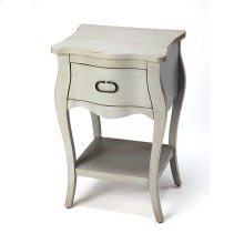 Crafted from mango wood solids and wood products in aneutral finish, this nightstand is perfect for stowing bedside essentials. This lovely nightstand showcases a single drawer with iron hardware, a scalloped apron and lower display shelf.