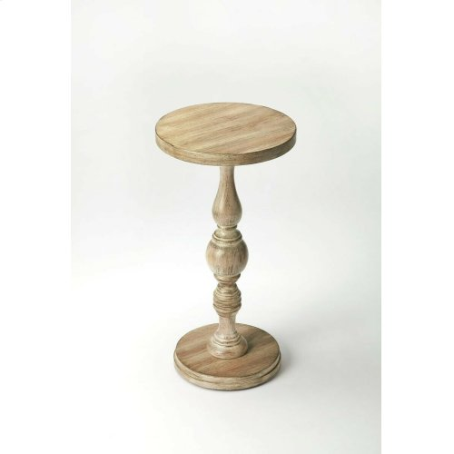 Elaborately carved pedestal connects the base with the double-decked tabletop to create a compelling aesthetic for a favorite nook or cranny. Crafted from rubberwood solids and wood products with a cherry veneer top in a Driftwood finish.