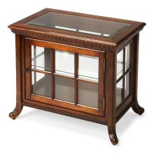 Selected solid woods and choice cherry veneers. Beveled glass top. Three glass sides and door with antique brass finished hardware. Adjustable glass shelf.