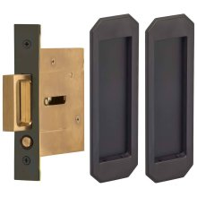 Passage Pocket Door Lock with Traditional Rectangular Trim featuring Mortise Edge Pull in (US10B Black, Oil-Rubbed, Lacquered)