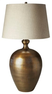 This classic table lamp will brilliantly light any space. Featuring an antique brass finish, it is hand crafted from aluminum with an iron harp and linen shade.