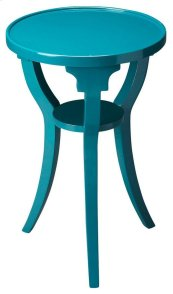 This Teal accent table is sure to energize any space. Crafted from select hardwood solids, wood products and birch veneer, this boldly-interpreted classic design has splayed legs for a modern flair. A small display shelf is present at the bottom, where yo