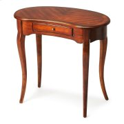 This elegant Writing Desk features a crescent shape tabletop supported by four stylized, tapered cabriole legs and a drawer with antique brass-finished hardware. It is crafted from solid poplar and cherry veneer in our Antique Cherry finish. Product Image