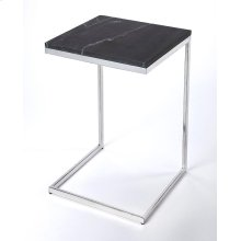 Glamour and minimalism intersect in the design of this modern end table. Elegantly finished in black marble and its natural variations that lend a sence of exclusive style; no two pieces are alike. The iron base is brightly finished in a polished nickel f