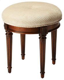 This splendid vanity stool adds formal elegance to any powder or dressing room. Handcrafted from hardwood solids and veneers, it features impeccably carved and tapered legs, ballerina feet, classic Olive Ash Burl finish and a comfortable seat upholstered