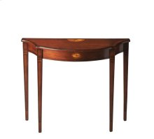 This Pembroke-inspired console features four elegantly tapered legs with decorative outlines, sweeping convex and concave curves, and linen-fold inlays on the top and apron. Crafted from hardwood solids with cherry, maple and walnut veneers, and finished