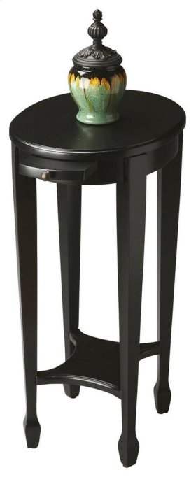 This attractive accent table is hand crafted from selected hardwood solids, wood products and choice veneers. It is perfectly proportioned to sit beside an easychair or serve as a bedside table. It features a matched cherry veneer top in a sleek black lic