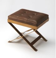 An updated version of the humble campaign stool, this charming ottoman adds extra seating and extra charm with buttery soft leather, hand-tufted in rich caramel. Brass finished metal frame adds durability, perfect for layering with a cozy throw or add a Product Image