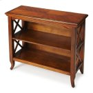 This stylish bookcase is a wonderful accent in a living room, family room, hallway or home office. Made for smaller spaces, versatility is one of its key attributes. Crafted from select hardwood solids and wood products, it features X-shaped side supports Product Image