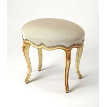 Fit for royalty, there's not a straight line found on this elegant oval hand painted vanity stool. Expertly crafted from rubberwood solids, it boasts a rich cream hand painted base with gold hand painted trim and carved flourishes on its legs. Silver fini