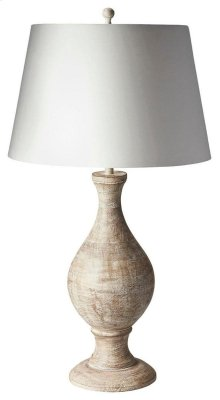 This classic table lamp will brilliantly light any space. Featuring an ivory toned finish, it is hand crafted from mango wood solids with an iron harp and cotton shade.