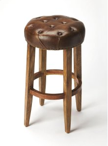 Perfect pulled up to your kitchen island or pub table, this elegant barstool showcases a button tufted leather seat with nail head trim for timeless appeal.