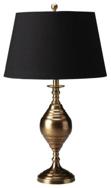 This classic table lamp will brilliantly light any space. Featuring an antique brass finish, it is hand crafted from aluminum with an iron harp and a cotton shade.