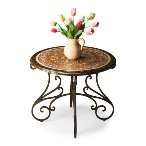 This stunning foyer table features an acid-etched pastor fossil stone veneer top elegantly outlined with a green fossil stone veneer border. The hand forged steel base has a dark pewter finish with gold undertones. At 30 high and with a four legged base,