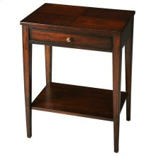The Cobble Hill Plantation Cherry console table is a richly finished cherry veneer over hardwood solids. The sleek tapered legs support a lower shelf for additional storage. The single drawer with a metal pull is the perfect place to tuck away your remote