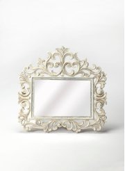 Accent your entryway or create a lovely focal point above the dresser with this elegant rectangular wall mirror, showcasing a floral scrollwork whitewashed wood frame with lily like details. Product Image