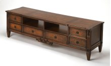 Sure to shine as the centerpiece of your living room ensemble, this TV stand is ready for movie nights and binge-watches alike. Founded atop tapered feet, its frame is crafted of solid and manufactured wood, with Cherry and Olive Ash Burl veneers, for Tra