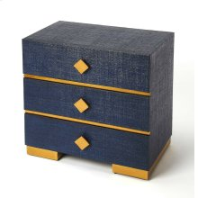 Add statement-making style to your favorite aesthetic with this three-drawer console chest, showcasing royal blue raffia and georgeous gold hardware and accents. Its blue adds a sophisticated touch to any space while its understated silhouette blends effo
