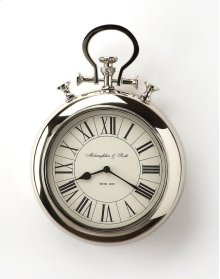 This wall clock is crafted in a round chrome tone frame that features Roman numerals over a white face, and a sturdy handle. The clock can be placed on any wall and blends with a variety of decor. Makes a great gift.