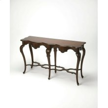 This French Provincial-inspired console features six stylized cabriole legs joined by a sinuous stretcher. Hand crafted from poplar hardwood solids and wood products with cherry veneers, it boasts a sumptuous Plantation Cherry finish.