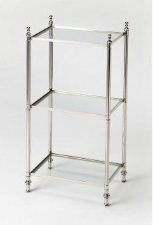 With its open look and compact footprint, this versatile end table brings function to your home without overwhelming smaller spaces. This rectangular piece is founded on four turned feet, framed with metal, and outfitted with three tempered clear glass ti