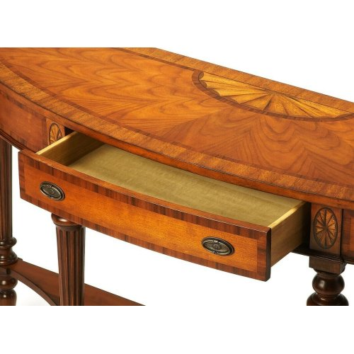 Selected solid woods and choice veneers. Inlaid top, drawer fronts and apron with anegre, rosewood, myrtle burl and crown cherry veneers. Drawer with antique brass finished hardware.