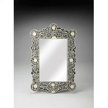 This magnificent Wall Mirror features sophisticated artistry and consummate craftsmanship. The botanic patterns covering the piece are created from white bone inlays cut and individually applied in a sea of black by the hands of a skillful artisan. No two