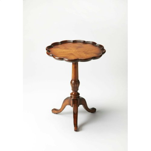 Add a touch of traditional sophistication to home decor with this lovely round pedestal table. Crafted of solid woods, wood products and Oak veneers, this elegant accent table is the perfect piece to display decorative items. Featuring a Vintage Oak finis