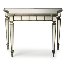 This beautiful console table will make a dramatic statement in the foyer or other living space. Expertly crafted from hardwood solids and wood products, it boasts graceful curves and antique mirror inlays on its top, apron and legs with a contrasting pewt