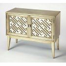 Glam meets mid-century modern style with this eye-catching console cabinet. Crafted of solid and manufactured wood in a hand applied Antique Silver Leaf finish, this charming design features geometric latticework doors complete with aged gold-toned hardwa Product Image
