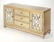 Glam meets function with this eye-catching sideboard cabinet. Crafted of Acacia wood and Birch veneers in a warm Champagne brushed finish that boasts of elegance. The fine latticework in an Art Deco design is enhanced by the reflection of the mirror glass
