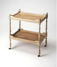 This traditional serving cart will stylishly enhance your space in use as a drink cart or a nightstand. Featuring an airy Driftwood finish and four antique brass casters for easy mobility, it is hand crafted from rubberwood solids and wood products with c