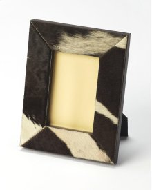 Leather and cowhide picture frame with a spotted motif.