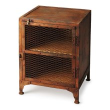This unique industrial chairside chest could have come right out of an iron works factory. Made from cast iron with a rust brown finish, it has two display shelves concealed by a wire, mesh door.