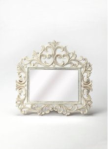 Accent your entryway or create a lovely focal point above the dresser with this elegant rectangular wall mirror, showcasing a floral scrollwork whitewashed wood frame with lily like details.