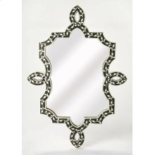 A work of art in any space, this gorgeous wall mirror has a truly unique free form shape with ribbon twists along its sides, top and bottom. Skillfully crafted from resin and wood products, its captivating botanic pattern is formed from hundreds of hand-c