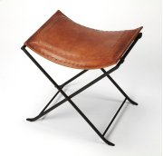 Leather meets iron for a simple seat, ideal for any spot in your home. Great alone or in multiples, its carefully stitched warm brown leather seat is supported by an understated black iron base that folds eaily for storage. Product Image