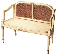 This elegant bench will add a touch of Old World charm to an entryway or any other traditional space. Carefully crafted from poplar and rubberwood solids, it boasts an antiqued cream and gold hand painted finish with a durable woven cane back.