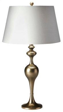 This elegant table lamp will brilliantly light any space. Featuring an antique brass finish, it is hand crafted from aluminum with an iron harp and a cotton shade.