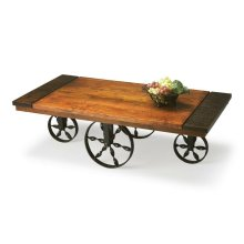 The perfect complement for rustic setting, this Wagon Cocktail Table is handcrafted from solid acacia wood and wrought iron in a heavily distressed burnt sienna finish.