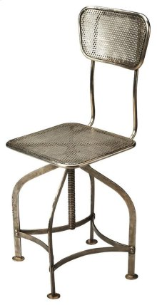 Sitting comfortably in a vintage industrial zone, this wonderfully low-tech, iron Swivel Chair can be adjusted to the ideal height simply by turning the seat.