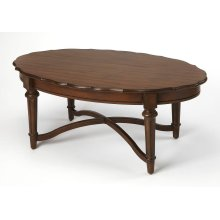 Anchor your living room seating group with this Country French style coffee table, the perfect stage for any display, featuring a classic oval shape, framed by a scalloped top, and a beautifully curved x-frame stretchers.