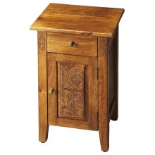 The warm amber finish provides the perfect complement to this Chairside Chest's simple lines, brass-finished hardware and botanic flourishes carved on door panel and either side of the drawer front. An instant classic crafted from mango wood solids and wo