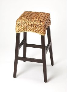 Enhance your kitchen, bar or work space with this transitional rattan barstool. Crafted from gemelina wood solids with a dark brown wood stain, it features a square hand woven banana rattan seat in a natural finish.