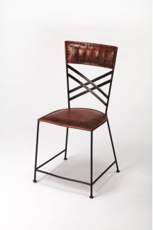 Leather and iron are combined for a rustic industrial aesthetic popular in contemporary design today. Understated with careful leather stitching in warm brown finish and criss-cross iron back panel, this side chair works well alone or in sets!