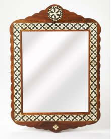 This arched top wall mirror is an extraordinary feat of craftsmanship. Its wondrous Moroccan quatrefoil design is painstakingly created inlaying bone ™ within a merranti wood frame ™ one individual piece at a time. Its hand rubbed finish will elegantly bl