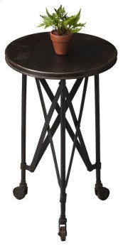 Crafted from iron on iron casters, this aged, industrial-look accent table evokes the charm of a by-gone era. It features a distinctive interlaced base linking legs and tabletop.