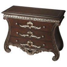 This magnificent Console Chest, featuring meticulous carvings and voluptuous curves, is crafted from gemelina solids with maple veneers on top and sides, then finished in rich espresso brown with hand-painted silver highlights.